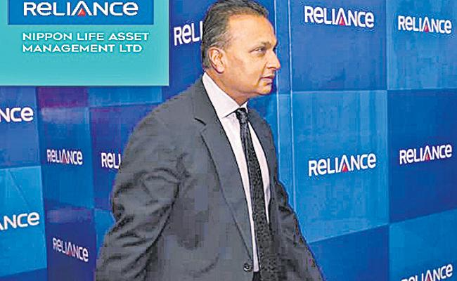 Anil Ambani to withdraw defamation suits against Congress, Herald - Sakshi