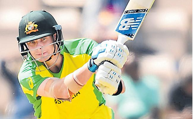 Smith century carries Aussies to warm up win - Sakshi