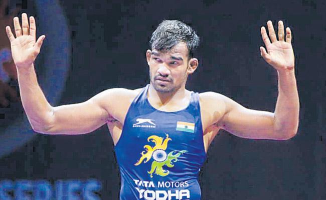 Nine medals for Indian Wrestlers - Sakshi