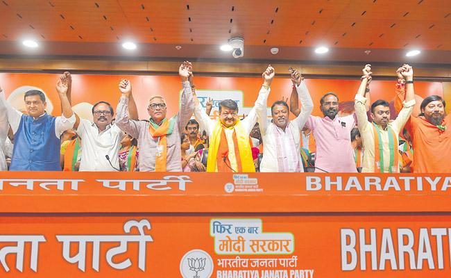 2 TMC MLAs over 50 councillors join BJP - Sakshi
