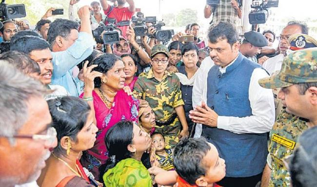 Maharashtra CM Devendra Fadnavis to visits of Gadchiroli Naxal attack  - Sakshi