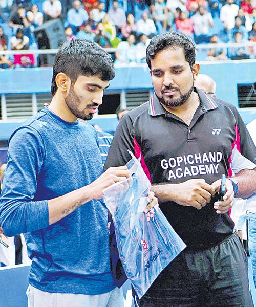 Badminton Coach Siyadutt In Top - Sakshi
