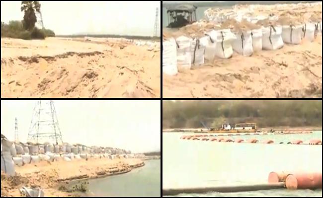 Revenue Officers Respond on Sand Mafia At Vijayawada - Sakshi