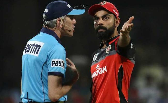 Umpire Nigel Llong In Trouble For Kicking Door After Row With Kohli - Sakshi
