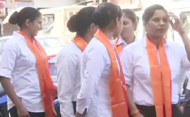 DIG Denies They Are Part of Force Who Wear Saffron Scarves at Digvijay Singh Road Show - Sakshi