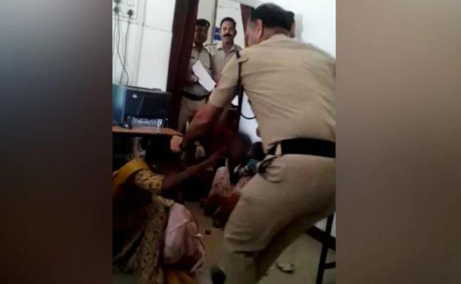 Inside Station Gwalior Cop Caught On Camera Hitting Woman With Child  - Sakshi