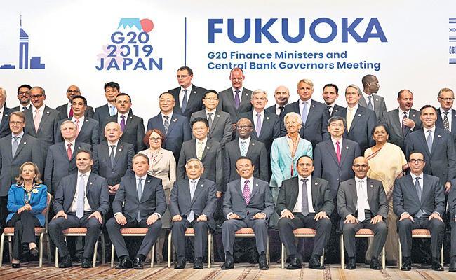 G20 Warning on World economy System - Sakshi