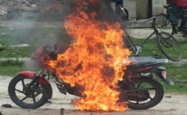 Man Burned Bike in Alcohol Conflicts Hyderabad - Sakshi