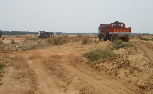 Free Sand Scheme Cancelled In AP - Sakshi