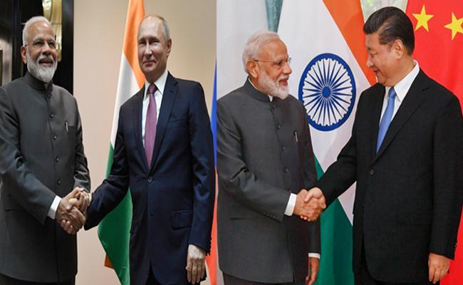 Modi Meets Putin Xinping Over Sco Meet - Sakshi