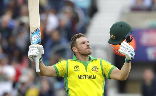 Finch hundred drives Australia - Sakshi
