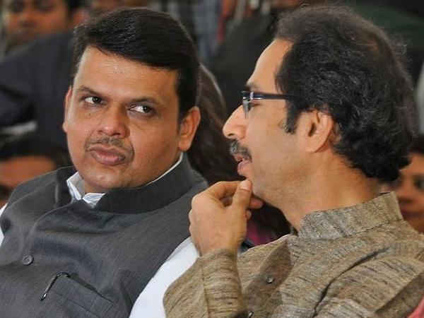 Devendra Fadnavis Meets Uddhav Thackeray Ahead Of Cabinet Expansion - Sakshi