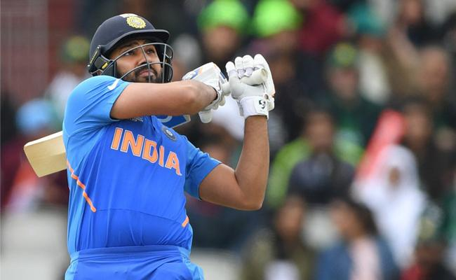 Rohit fifty powers India to strong start - Sakshi