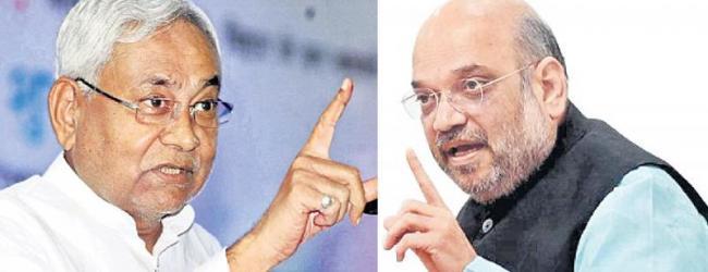 JDU cutting with BJP - Sakshi