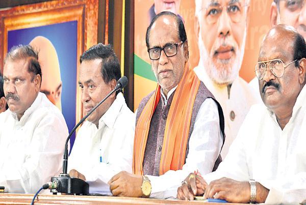 K Laxman Fires On KCR Govt - Sakshi