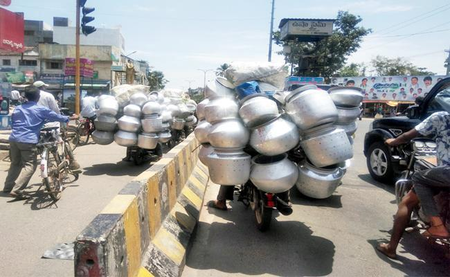 Two Wheelers Going With Overload In Anakapalle, Visakapatnam - Sakshi