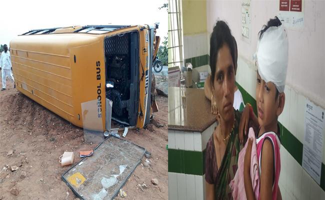School Bus Rolled Over Big Stone Near Deverakonda - Sakshi
