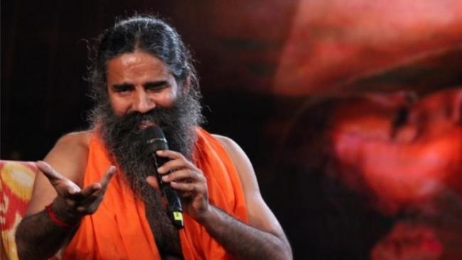 Ramdev Praised PM Modi For Popularising Yoga - Sakshi