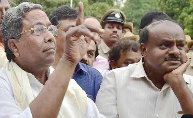 AICC Dissolves Karnataka Pradesh Congress Committee - Sakshi