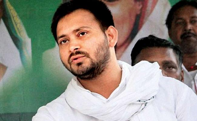 Tejashwi Yadav Maybe In England For world Cup Says RJD leader - Sakshi
