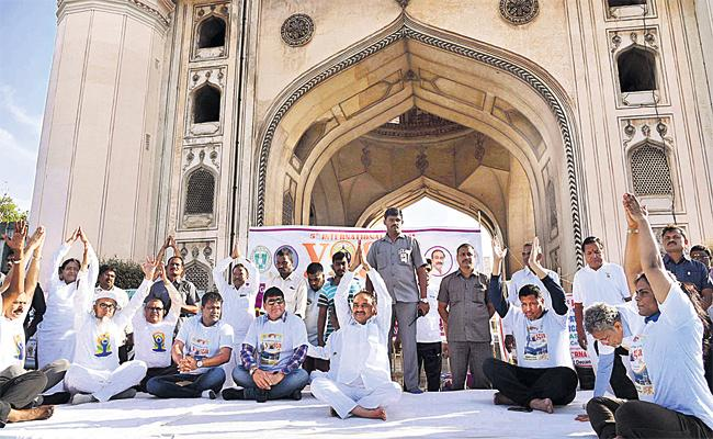 Etela Rajender Yoga Day Celebrations in Charminar - Sakshi