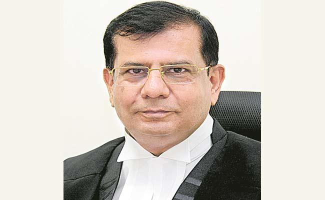 Justice Raghvendra Singh Chauhan Appointed As Telangana High Court CJ - Sakshi