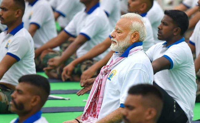 International Yoga Day Narendra Modi Said Yoga Belongs to Everyone - Sakshi