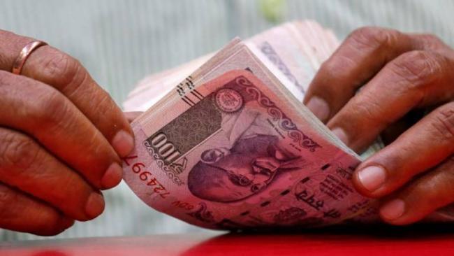 Rupee opens lower at 69.75 per dollar - Sakshi