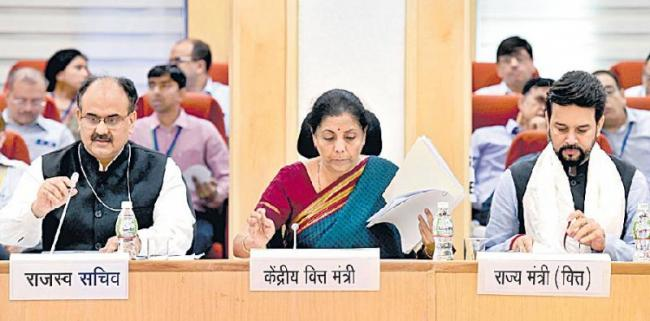 Sitharaman led first GST Council meet to decide on tax cut on e vehicles - Sakshi