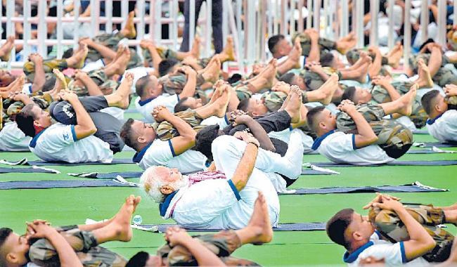 Narendra Modi on International Yoga Day - Sakshi