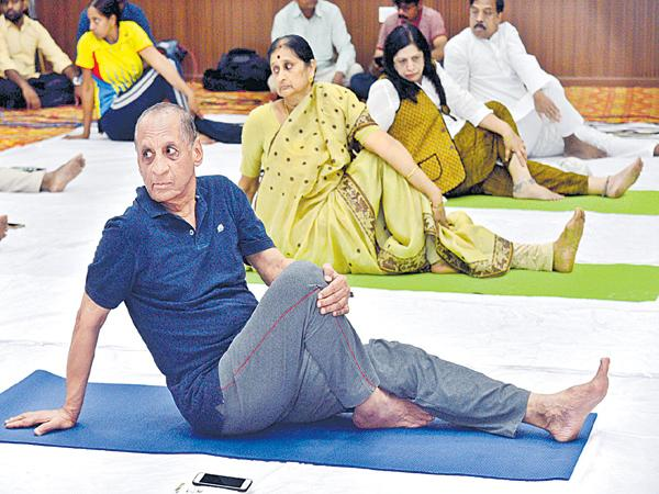Governor couple participating in yoga celebrations - Sakshi