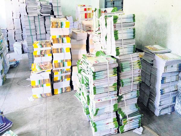 Textbooks is went to the government schools - Sakshi