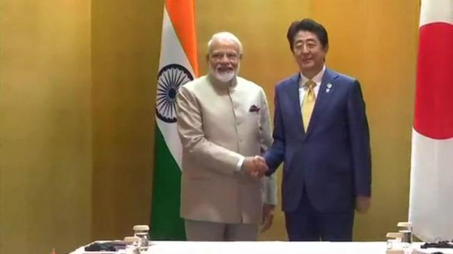 PM Modi Japan PM Discuss Global Trade - Sakshi