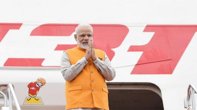 PM Modi Lands In Japans Osaka - Sakshi