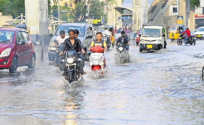 GHMC And HMRL War On Rain Water - Sakshi