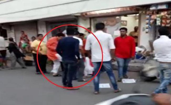 Ahmedabad BJP MLA Balram Thavani Kicks Woman - Sakshi