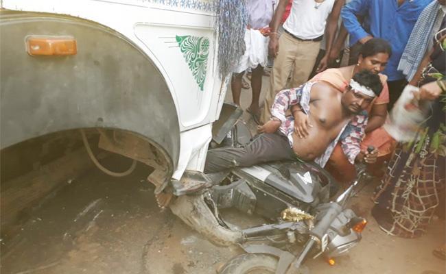 Man Injured in Bike Accident Krishna - Sakshi
