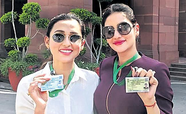 TMC MPs Mimi Chakraborty And Nusrat Jahan trolled for Parliament photos  - Sakshi