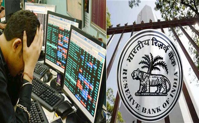 Sensex Extends Decline, Falls Over 450 Points Even As RBI Cuts Interest Rate - Sakshi