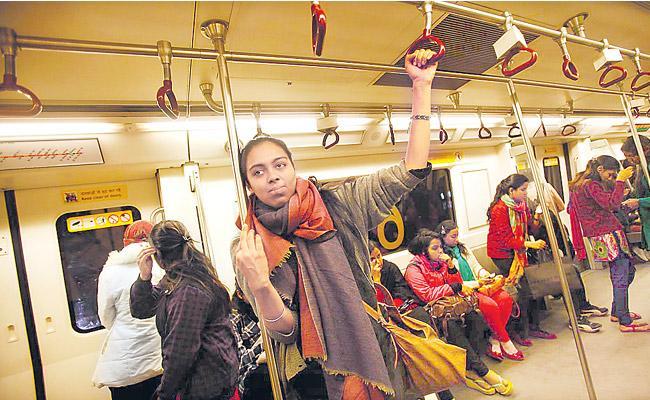 Women counter Arvind Kejriwal decision to make Metro bus rides free - Sakshi