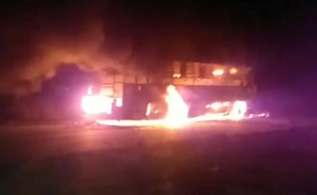 Private Travels Bus Catches Fire At Kurnool - Sakshi