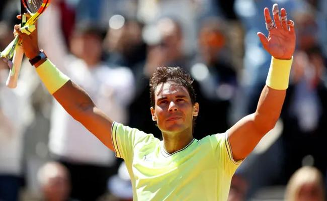 Rafael Nadal Defeats Roger Federer to Reach the French Open Final - Sakshi