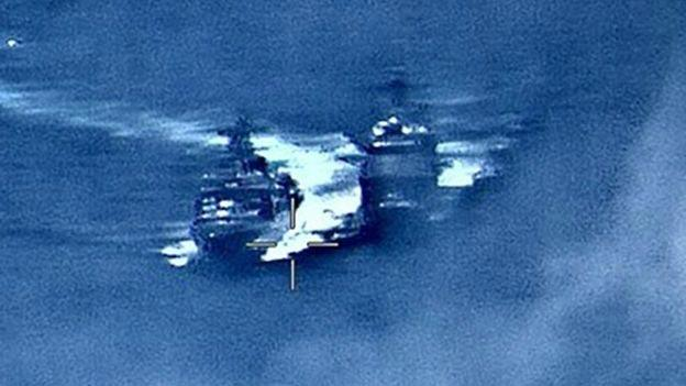 Russian and US warships almost collide in East China Sea - Sakshi