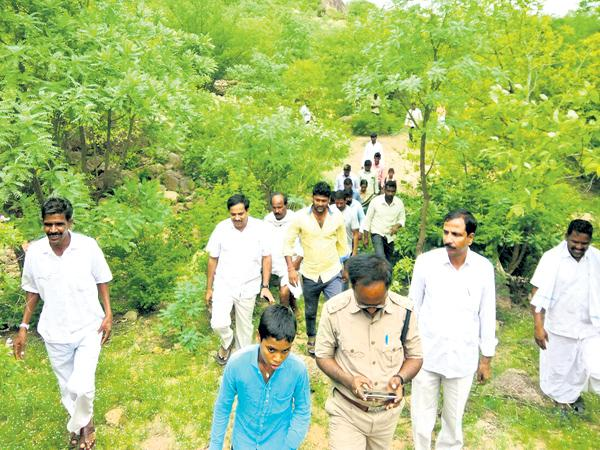 MLC walking a kilometer in the jungle - Sakshi