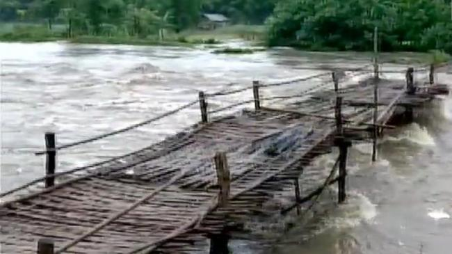 Brahmaputra River Crosses Danger Mark Due To Assam Floods   - Sakshi