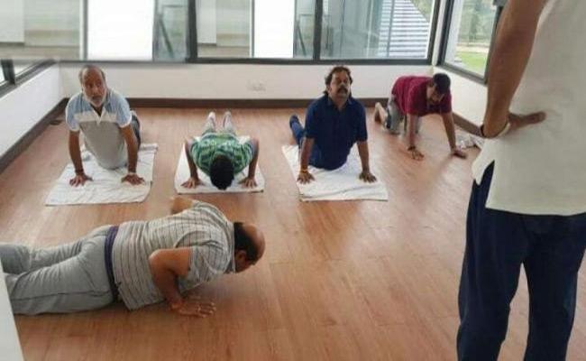 JDS MLAs Practise Yoga At Bengaluru Golf Resort - Sakshi