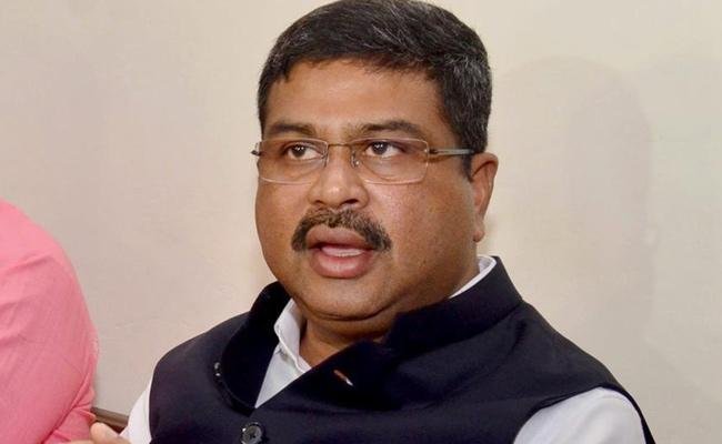 No Planings To Move Petrol Under GST Says Dharmendra Pradhan - Sakshi