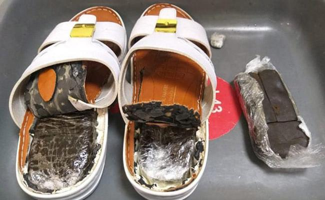 Kerala Man Arrested At  Kannur Airport Hashish Hidden In Slippers - Sakshi
