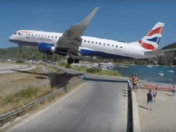 Plane Landing Just a Few Feet Away from Tourists In Greece - Sakshi