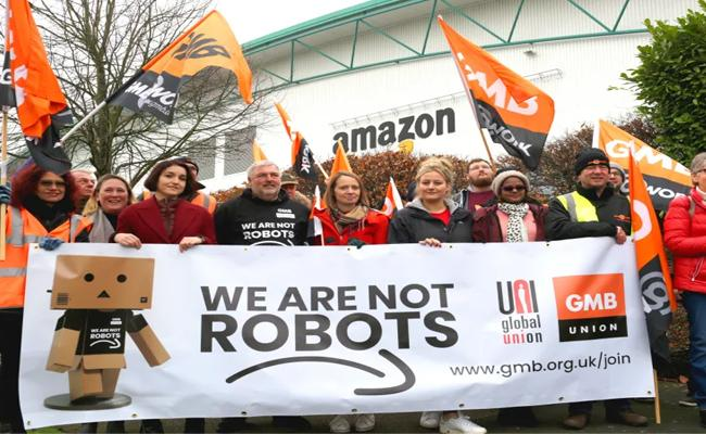 Amazon workers stage protest as Prime Day kicks off - Sakshi